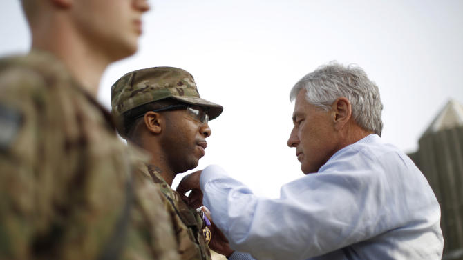 U.S. Defense Secretary Chuck Hagel participates in the awarding of a Purple Heart to Sgt. Jeremyah Williams of the 426 Brigade Support Battalion, at Jalalabad Airfield in eastern Afghanistan, Saturday, March 9, 2013. It is Hagel's first official trip since being sworn-in as President Barack Obama's defense secretary. (AP Photo/Jason Reed, Pool)