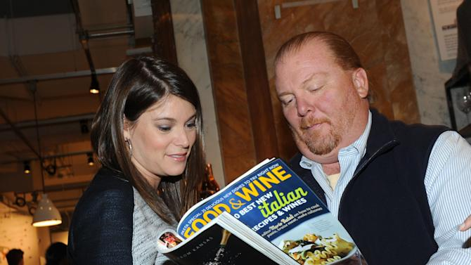 Gail Simmons, left, of FOOD & WINE and Bravo's Top Chef, with Mario Batali, the guest-editor of the April issue of FOOD & WINE, during a party at Eataly in New York, Wednesday, March 6, 2013.  (Photo by Diane Bondareff/Invision for FOOD & WINE/AP Images)