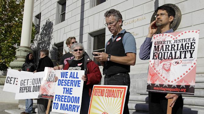 FILE - This Nov. 17, 2011 file photo shows gay marriage supporters outside the California Supreme Court in San Francisco. The Supreme Court will take up California's ban on same-sex marriage, a case that could give the justices the chance to rule on whether gay Americans have the same constitutional right to marry as heterosexuals.  (AP Photo/Eric Risberg, File)