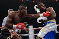 Cuba's Guillermo Rigondeaux (L) during his WBA super-bantamweight title fight against Teon Kennedy on June 9. Rigondeaux retained his super-bantamweight world title with a fifth-round technical knockout of Kennedy