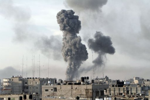 Smoke billows after Israeli air strikes near smuggling tunnels between the southern Gaza Strip and Egypt in Rafah. Five Palestinians were killed in Israeli air strikes on Gaza City, raising the day&#39;s toll to nine and, and hiking the overall number of people killed to 146, medics said