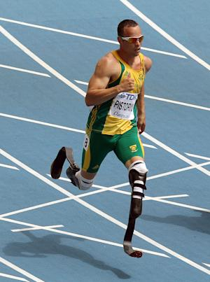 FILE - This Aug. 28, 2011 file photo shows South Africa's Oscar Pistorius competing in a heat of the men's 400-meter at the World Athletics Championships in Daegu, South Korea. The South African double amputee is going to the London 2012 Olympics, re-igniting the fierce debate over the carbon fiber blades he runs on and his right to compete alongside able-bodied athletes. (AP Photo/Kevin Frayer, File)
