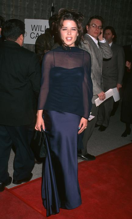Neve Campbell in a navy gown and sheer shawl