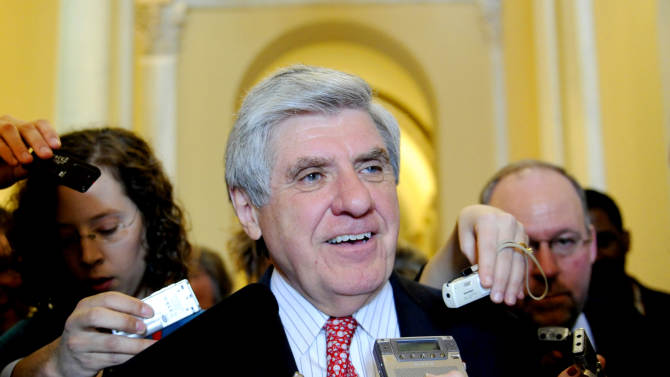 FILE - In this file Feb. 11, 2009 file photo, Sen. Ben Nelson, D-Neb. talks to reporters on Capitol Hill in Washington. Sources say Nelson will retire. (AP Photo/Susan Walsh, File)