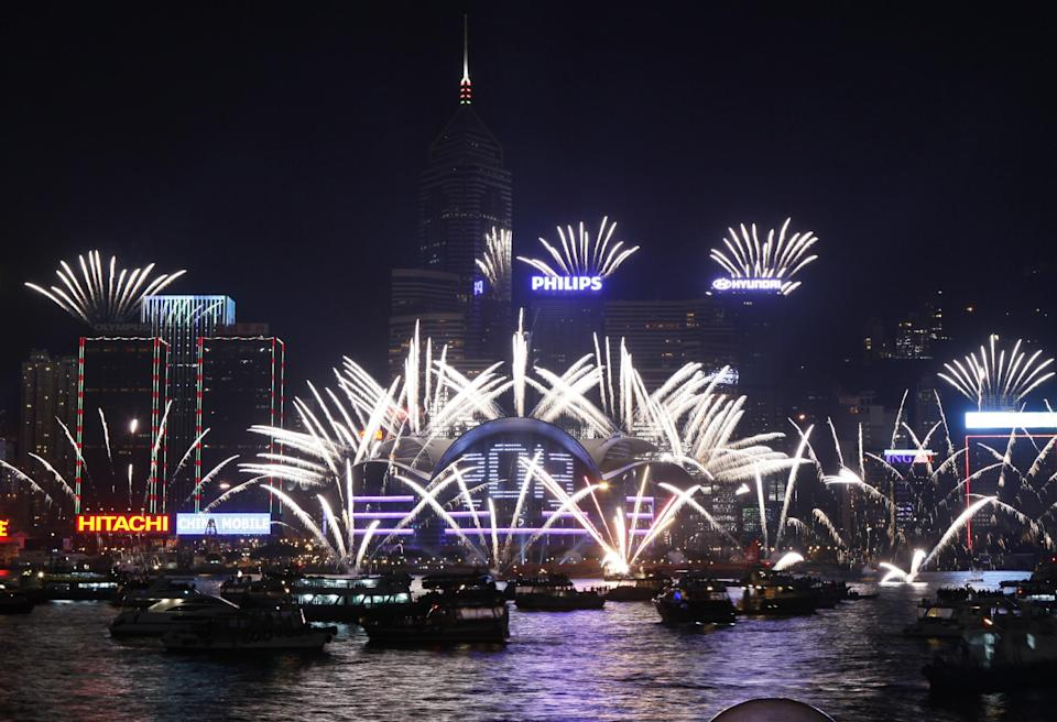 Fireworks explode at the Hong Kong Convention and Exhibition Centre over the Victoria Harbor to celebrate the 2013 New Year in Hong Kong Tuesday, Jan. 1, 2013  (AP Photo/Kin Cheung)