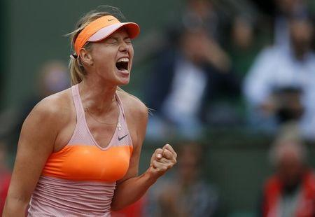 Maria Sharapova of Russia reacts during her women's quarter-final match against Garbine Muguruza of Spain at the French Open tennis tournament at the Roland Garros stadium in Paris