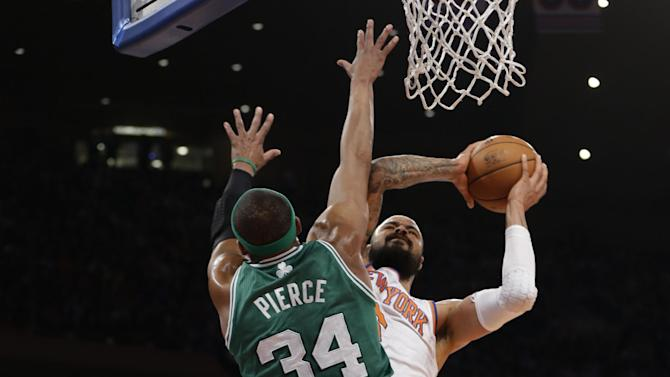 Boston Celtics forward Paul Pierce (34) defends a shot by New York Knicks center Tyson Chandler (6) in the first half of Game 2 of their first-round NBA basketball playoff series in New York, Tuesday, April 23, 2013. (AP Photo/Kathy Willens)