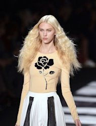 A model presents a creation by Viktor & Rolf during the Spring/Summer 2013 ready-to-wear collection show in Paris. The Dutch design duo served up Hollywood in a mirror with a cool cocktail of drapes and shimmer showcased midway through Paris Fashion Week