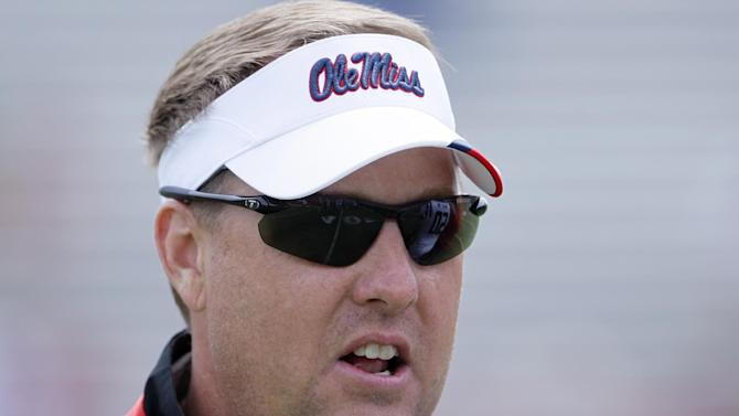 Mississippi football coach Hugh Freeze calls out to his players during their team's NCAA college football spring scrimmage on Saturday, April 5, 2014, in Oxford, Miss