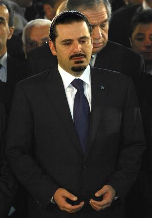 Lebanon's caretaker Prime Minister Saad Hariri prays at his father's grave, former Prime Minister Rafik Hariri, marking the sixth anniversary of his assassination in Beirut, Lebanon, Monday, Feb. 14, 2011. Rafik Hariri was killed in a massive truck bombing in Beirut in 2005. An international tribunal set up to try his killers has yet to identify the perpetrators. The tribunal is widely expected to accuse Hezbollah members of involvement in the killing. (AP Photo)