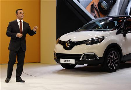 Ghosn,Chairman and CEO of the Renault-Nissan Alliance gestures during the presentation of the Captur car during the first media day of the 83rd Geneva Car Show in Geneva