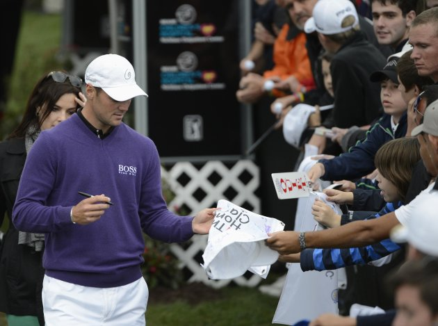 Kaymer of Germany signs autographs after finishing the second round play in the PGA golf tournament in Palm Beach Gardens