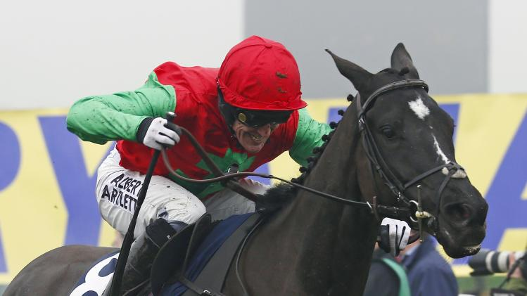 Tony McCoy on Taquin Du Seuil wins the Novices Steeple Chase at the Cheltenham Festival horse racing meet in Gloucestershire