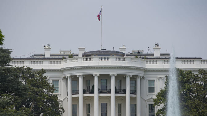 FILE - This May 9, 2014, photo shows the South Portico of the White House in Washington. Frustrated by criticism of President Barack Obama's foreign policy, White House officials have been holding private meetings this week aimed at soothing lawmakers' concerns over the U.S. posture in Syria, the future of the American military presence in Afghanistan, and defense spending. (AP Photo/Pablo Martinez Monsivais, File)