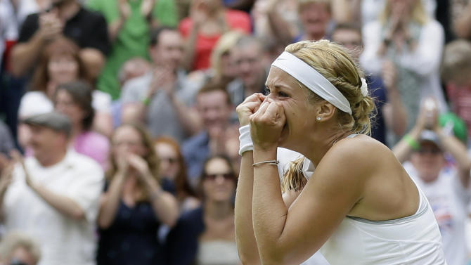Sabine Lisicki of Germany celebrates after beating Serena Williams of the United States in a Women's singles match at the All England Lawn Tennis Championships in Wimbledon, London, Monday, July 1, 2013. (AP Photo/Alastair Grant)