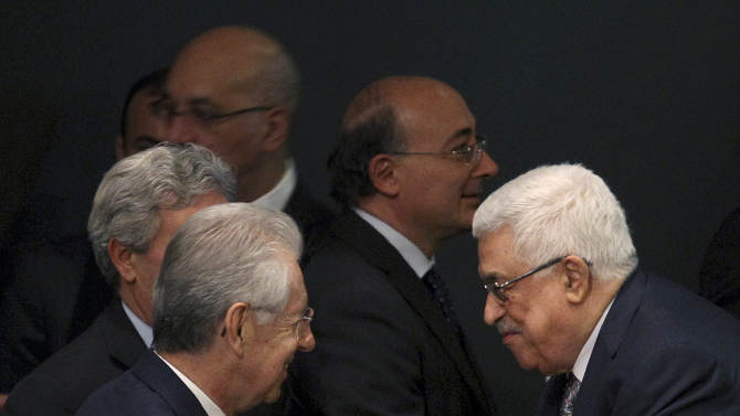 Palestinian President Mahmoud Abbas, right, greets Italian Premier Mario Monti during the 67th session of the General Assembly at United Nations headquarters Tuesday, Sept. 25, 2012. (AP Photo/Seth Wenig)