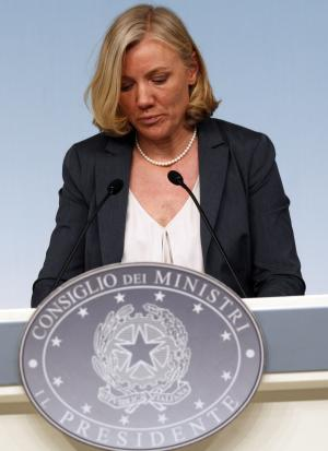 Italian Minister for Sports Josefa Idem attends a press conference at Chigi palace, Premier's office, in Rome, Saturday, June 22, 2013. Premier Enrico Letta's cross-party government is facing one of its first major fissures as pressure mounts for the equal opportunities minister to resign over tax troubles. Josefa Idem, a German-born eight-time Olympic kayaker, has admitted that there were irregularities in the tax payments on one of her residences. She has apologized, saying she had trusted professionals to build and register the structure correctly, and said the problems were being fixed. (AP Photo/Alessandra Tarantino)