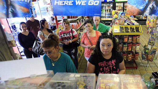 People stand in line as they prepare to buy lottery tickets for the Mega Million Jackpot, which is estimated at $540 million dollars Thursday March 29, 2012 at the Town and Country in McAllen, Texas. (AP Photo/The Monitor, Gabe Hernandez)  MAGS OUT; TV OUT