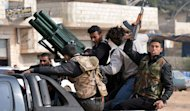 Rebel fighters prepare to fight against Syrian regime forces in the village of Kurnaz, close to the western city of Hama, on January 27, 2013