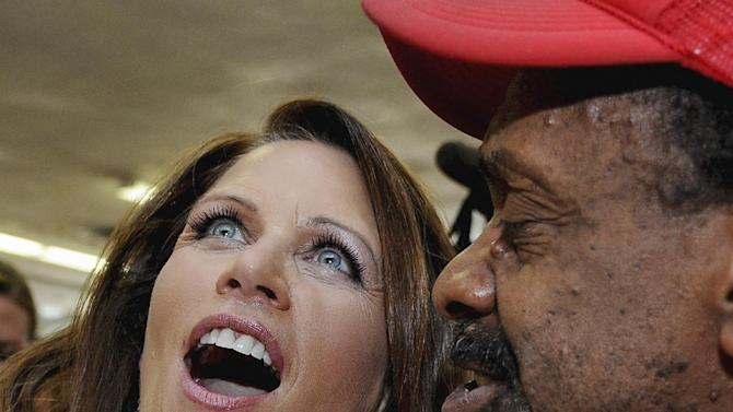 Republican presidential candidate, Rep. Michele Bachmann, R-Minn., left, calls out orders with Tommy Rice at the Beacon Drive-in, Tuesday, August 16, 2011, in Spartanburg, S.C. (AP Photo/ Richard Shiro)
