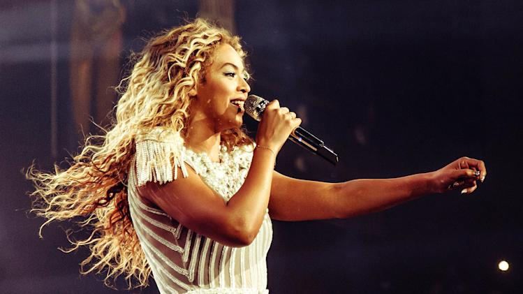 "This publicity image released by Parkwood Entertainment shows singer Beyonce performing during her world tour on Saturday, July 13, 2013 at the Bridgestone Arena in Nashville, Tenn. Beyonce called for a moment of silence for Trayvon Martin during a concert just hours after George Zimmerman was found not guilty by a Florida jury on Saturday. After asking the crowd to be silent a moment, she sang the chorus of ""I Will Always Love You,"" a song written by country music star Dolly Parton and brought to a global audience by the late Whitney Houston. (AP Photo/Parkwood Entertainment, Robin Harper)"