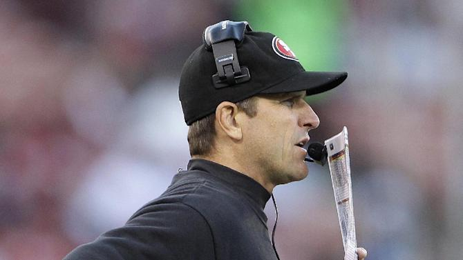 San Francisco 49ers coach Jim Harbaugh watches from the sideline during the second half of an NFL preseason football game against the Minnesota Vikings in San Francisco, Friday, Aug. 10, 2012. (AP Photo/Paul Sakuma)