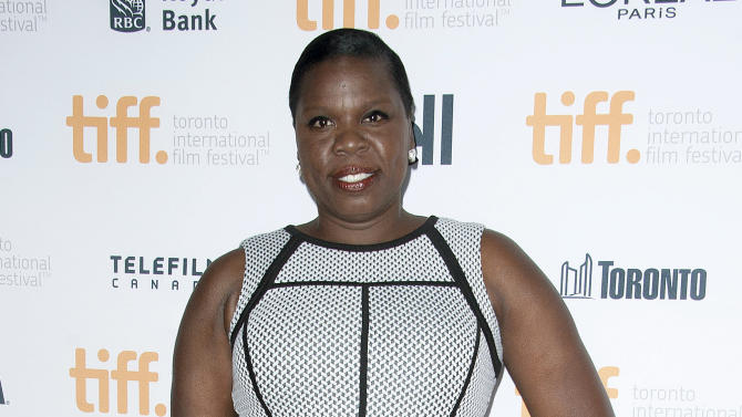 """FILE - In this Sept. 6, 2014 file photo, actress Leslie Jones poses at the """"Top Five"""" premiere at the Princess of Wales Theatre during the 2014 Toronto International Film Festival in Toronto. NBC says """"Saturday Night Live"""" is adding Leslie Jones to its cast. The African-American comedian wins her on-camera role after serving as a writer on the show last season. (Photo by Arthur Mola/Invision/AP, File)"""