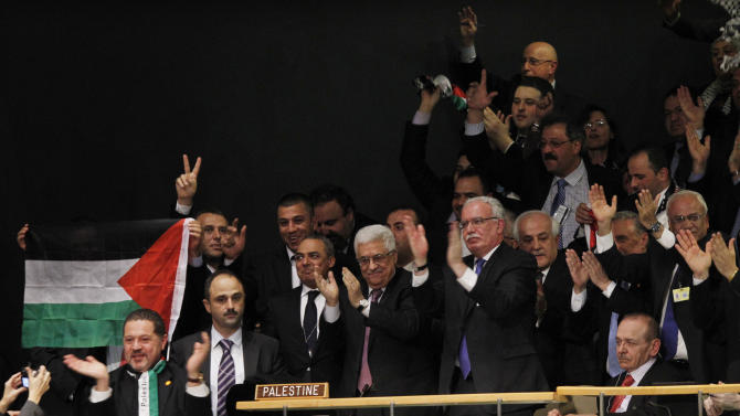 President of the Palestinan National Authority Mahmoud Abbas, center, celebrates with members of his delegation and other supporters after the U.N. General Assembly's historic vote to recognize Palestine as its 194th State at U.N. Headquarters, Thursday, Nov. 29, 2012. (Jason DeCrow/AP Images for Avaaz)