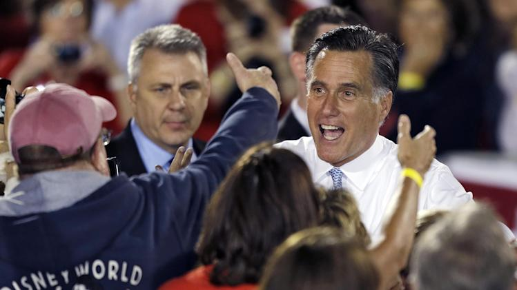 Republican presidential candidate and former Massachusetts Gov. Mitt Romney, right, shakes hands with supporters after a campaign speech Saturday, Oct. 27, 2012, in Land O' Lakes, Fla. (AP Photo/Chris O'Meara)