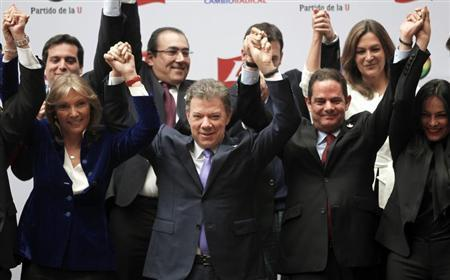 Colombia's President, and presidential candidate, Santos celebrates with his wife Maria Clemencia and his vice-presidential team-mate Lleras after registering their candidacy in Bogota