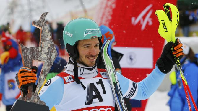 Third-placed Neureuther of Germany celebrates with his trophy after men's Alpine Skiing World Cup slalom in Kitzbuehel