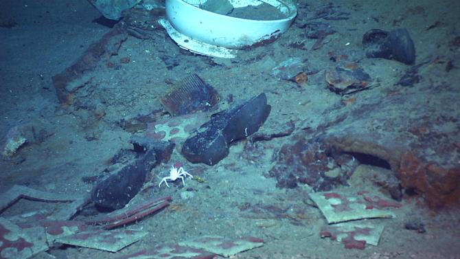 This photo provided by the Institute for Exploration, Center for Archaeological Oceanography/University of Rhode Island/NOAA Office of Ocean Exploration, shows The remains of a coat and boots, articulated in the mud on the sea bed near Titanic's stern, are suggestive evidence of where a victim of the disaster came to rest. (AP Photo/Institute for Exploration, Center for Archaeological Oceanography/University of Rhode Island/NOAA Office of Ocean Exploration)
