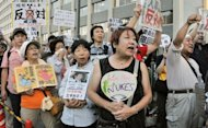 <p>Anti-nuclear protesters rally outside Japanese Prime Minister Yoshihiko Noda's official residence and parliament in Tokyo on August 3. Noda met anti-nuclear demonstrators face-to-face Wednesday for the first time since weekly rallies outside his office began five months ago.</p>