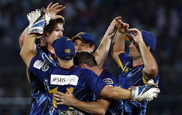 Otago Volts players celebrate fall of wicket during CLT20 match between Rajasthan Royals and Otago Volts at Sawai Mansingh Stadium in Jaipur on Oct. 1, 2013. (Photo: IANS)