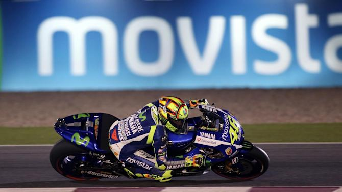 Italian MotoGP rider Valentino Rossi of the Movistar Yamaha MotoGP team steers his bike during a free practice session of the MotoGP World Championship at the Losail International Circuit in Doha , Qatar, Friday, March 27, 2015. The 2015 Qatar MotoGP takes place on Sunday March 29, 2015. (AP Photo/Osama Faisal)
