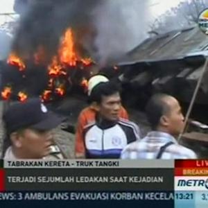 Train collides with truck in Indonesia, four dead.