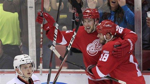 Banged-up Red Wings rally to beat Hurricanes 5-4