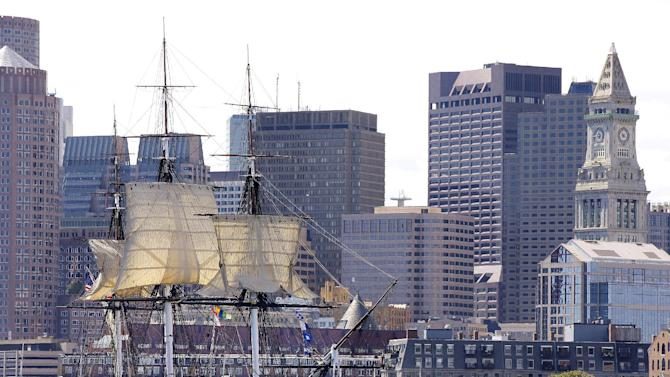 "The U.S.S. Constitution, or ""Old Ironsides,"" the U.S. Navy's oldest commissioned ship that is still afloat, is towed through Boston Harbor past the financial district skyline with its topsails unfurled Friday, Aug. 29, 2014 in Boston. The ship is setting its sails for the last time before the warship heads to dry dock for a three-year repair project. (AP Photo/Stephan Savoia)"