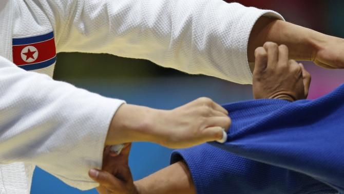 North Korea's Kim competes against Nepal's Maharjan during their men's -60kg preliminary judo match at Dowon Gymnasium during the 17th Asian Games in Incheon