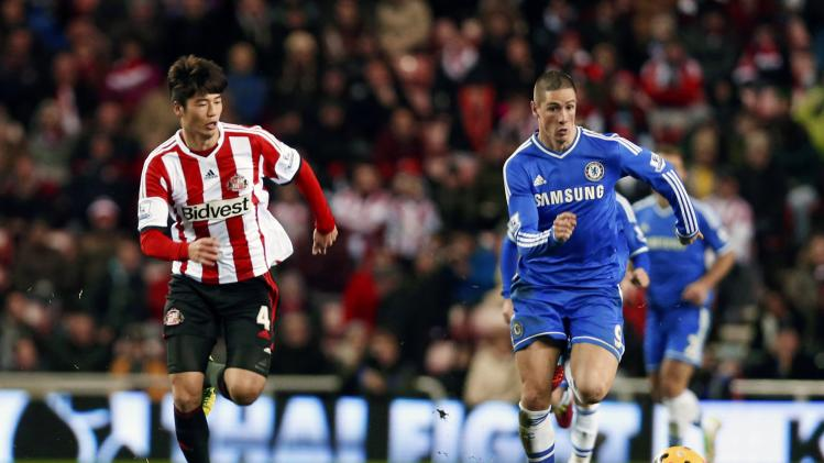 Sunderland's Ki challenges Chelsea's Torres during their English Premier League match in Sunderland