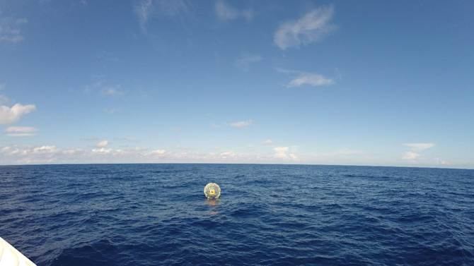 In this Oct. 1, 2014, photo provided by the U.S. Coast Guard, the Coast Guard arrives on scene off the coast of Miami to respond to a report of a man aboard an inflatable hydro bubble who was disoriented. Coast Guard air crew were able to safely pick up Reza Baluchi and the bubble Saturday, Oct. 4, Coast Guard spokeswoman Marilyn Fajardo said in a statement. (AP Photo/U.S. Coast Guard)