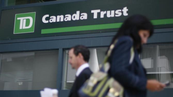 People walk past a Toronto Dominion Bank branch in Ottawa