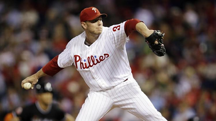 Philadelphia Phillies' Roy Halladay pitches in the second inning of a baseball game against the Miami Marlins, Tuesday, Sept. 11, 2012, in Philadelphia. (AP Photo/Matt Slocum)