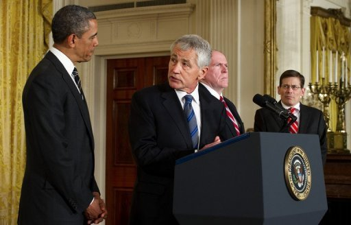 US President Barack Obama (L) listens as Chuck Hagel (2nd L), the president's nominee for defense secretary, speaks with CIA head nominee John Brennan (2nd L) and Acting Director Michael Morell (R) duing an event at the White House January 7, 2013