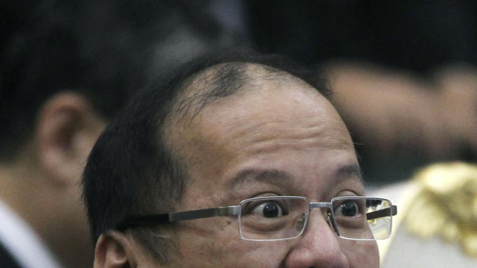 Philippines' President Benigno Aquino III reacts during the ASEAN Global Dialogue in Phnom Penh, Cambodia Tuesday, Nov. 20, 2012. (AP Photo/Apichart Weerawong)
