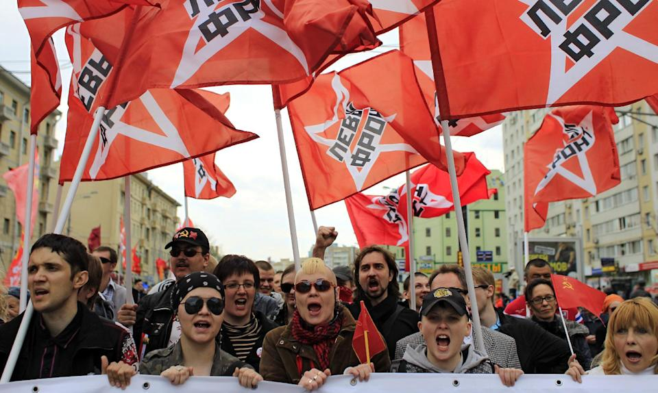 Young Communist Party supporters march during a rally to mark May Day in in Moscow, Tuesday, May 1, 2012. (AP Photo/Sergey Ponomarev)