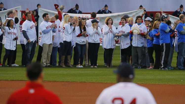 2013 Boston Marathon bombings' survivors are honored on the field during a pre-game ceremony before the MLB baseball game between Orioles and Red Sox at Fenway Park