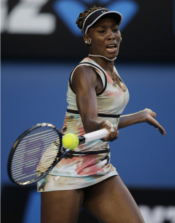 Venus Williams of the US hits a forehand to France's Alize Cornet during their second round match at the Australian Open tennis championship in Melbourne, Australia, Wednesday, Jan. 16, 2013. (AP