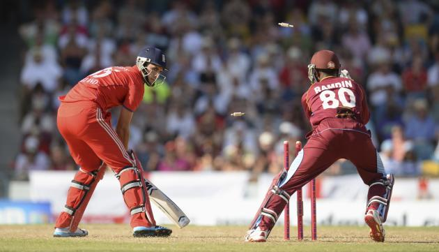 England's Hales looks on as he is stumped by West Indies' Ramdin during the first T20 international cricket match at Kensington Oval in Bridgetown