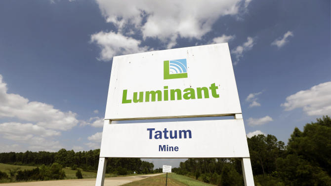 This July 29, 2013, photo shows the entrance to a Luminant Mining Co. coal mine in Tatum, Texas. Decades of mining and power plant activity that helped East Texas towns grow and thrive could be threatened as a large energy provider faces possible bankruptcy. (AP Photo/LM Otero)